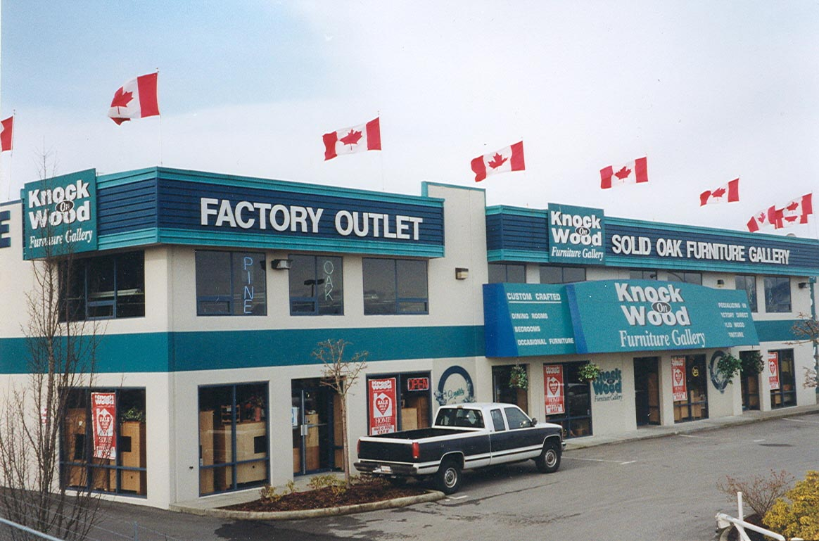 Roof top flagpoles at Knock On Wood furniture store